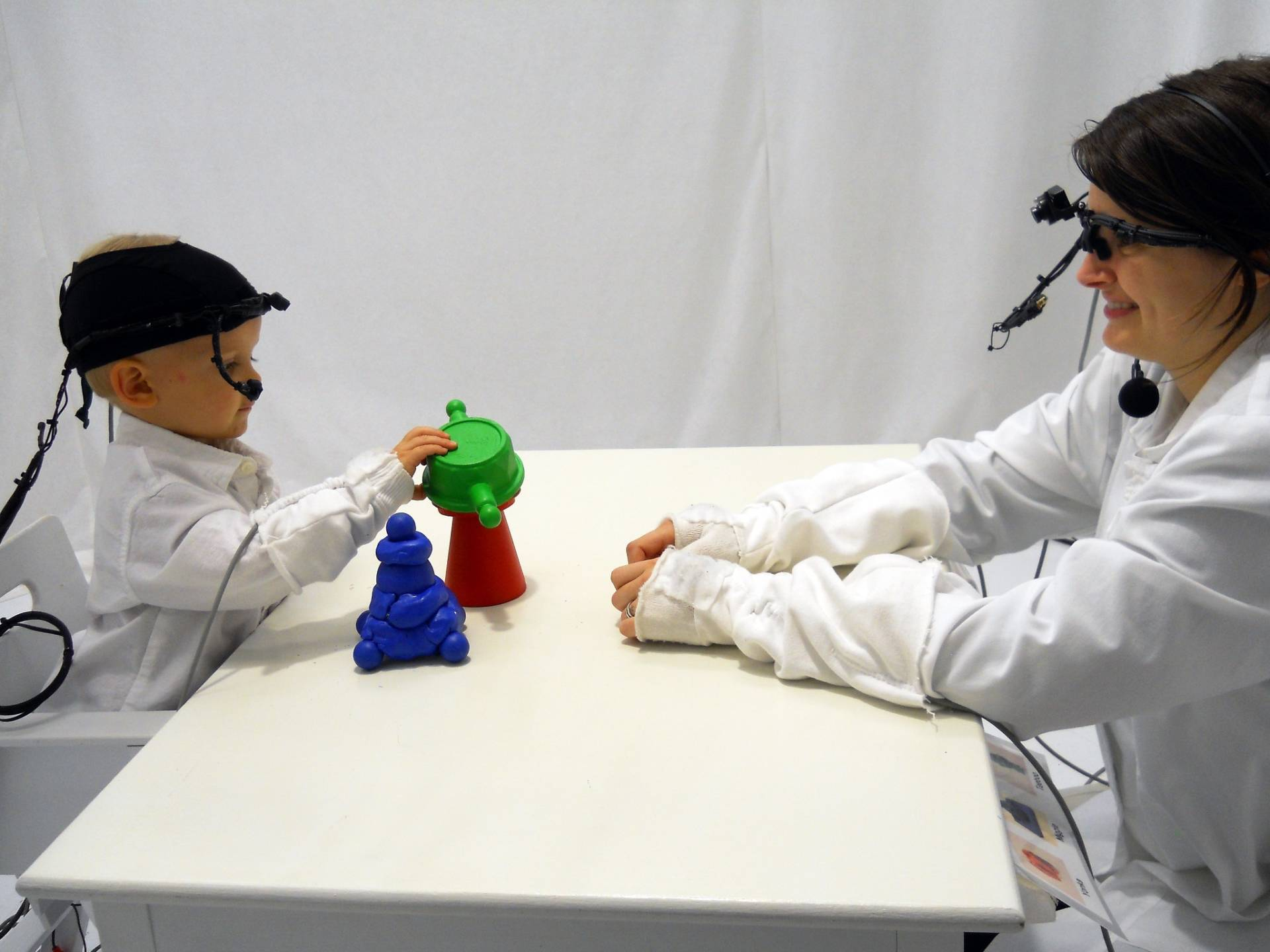 Head-mounted cameras enable psychologists to track how the movement of caregivers' eyes affect infants' attention. (Chen Yu)
